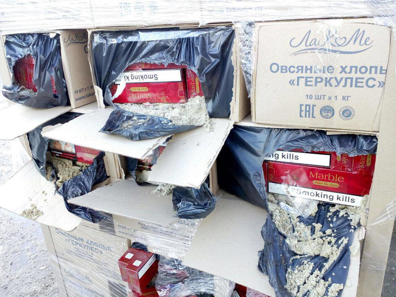 Корупція на Закарпатській митниці: в Румунію пропустили фуру з 450 ящиками цигарок, в Угорщину - 860 кг бурштину (ФОТО), фото-1