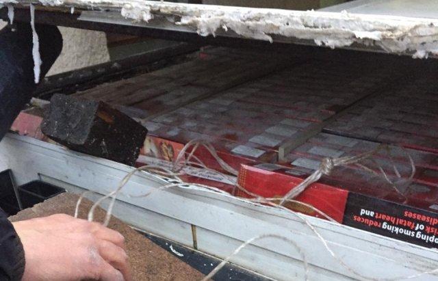 На Закарпатті затримали 43-річного чоловіка, який намагався перевезти до Румунії понад 20 тисяч пачок цигарок (ФОТО), фото-5